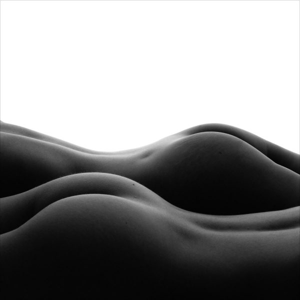 "Two nude figures form an abstract landscape, represented here in exquisite form rendered in ""Bodyscape Dunes"" limited edition, black and white print by photographer Aranka Israni"